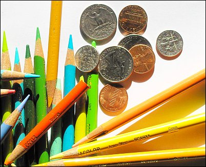 Photo of colored pencils and money