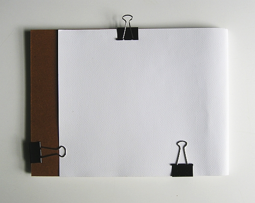 My Favorite Equipment for Drawing Outside - The Back of a Drawing Pad with a Working Mat